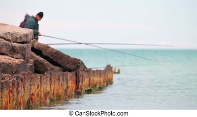 fishermen on old rusty pier