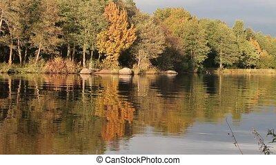 Fishermen on the autumn lake