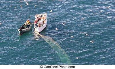 Fishermen on the boat