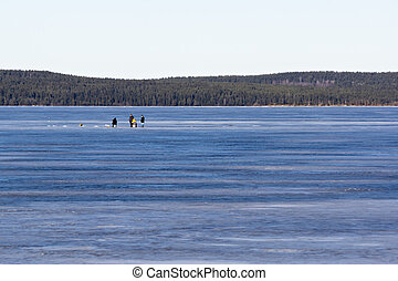 Fishermen on the ice fishing on the