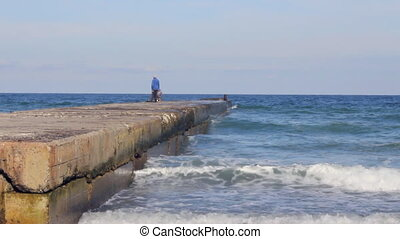 Fishermen on the pier in the sea