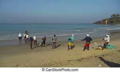 Fishermen pulling a trawl