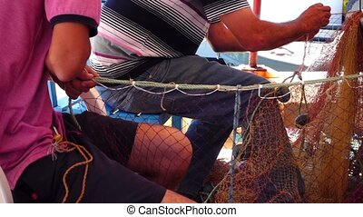 Fishermen Repair Fishnet Fishing Lines