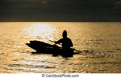 Fishermen rowing out to sea