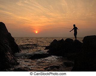 fishermen silhouette at sunset