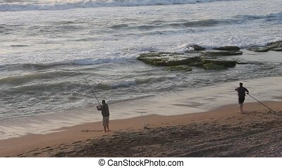 Fishermen - Two  Fisherman on the beach