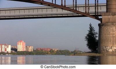 Fishermen under a bridge in Novosibirsk