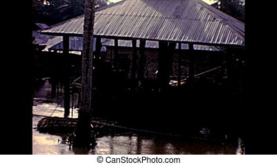 fishermen village with huts of Lagos island. Historical archival of Lagos city of Nigeria state of Africa in 1970s.