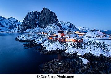 Fishermen?s cabins (rorbu) in the Hamnoy village at twilight in winter season, Lofoten islands, Norway
