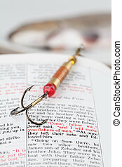 Fishers of men - Fishing hook on the Bible with focus on a ...