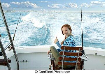 fisherwoman big game on boat chair ok sign happy