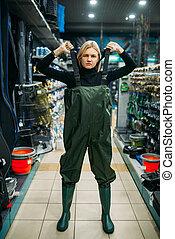 Fisherwoman in rubber jumpsuit, fishing shop - Fisherwoman ...