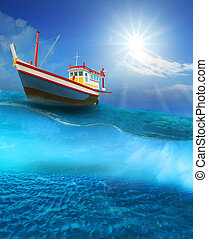 fishery boat floating on blue sea wave with sun shining on ...