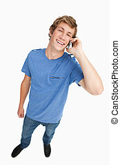 Fisheye view of a laughing male student on the phone