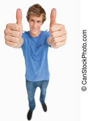 Fisheye view of a male student thumbs-up