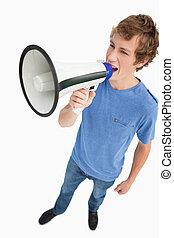Fisheye view of a male student yelling in a loudspeaker