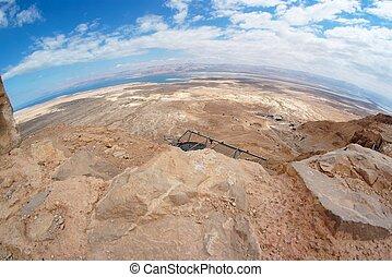 Fisheye view of desert landscape under Masada fortress near the Dead Sea