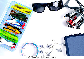 fishing accessories, box with silicone baits, fishing glasses, accessory box, fishing reel, hooks, braided fishing line on a white background, a place for copy space