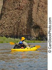 Fishing and Kayaking in a yellow kayak