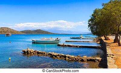 Fishing and pleasure boats off the coast of Crete.