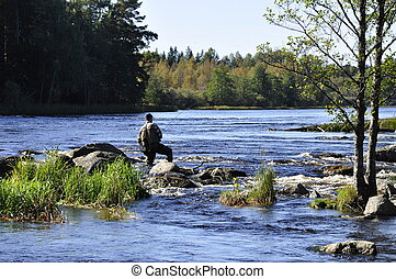 Fishing - Angler fishing in a river