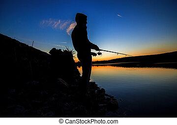 fishing at sunset near the sea 2