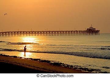 Fishing at the pier - A man fishing at a pier