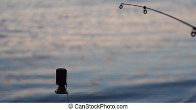 Fishing bell on river backside