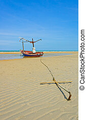 Fishing boat anchored on beach