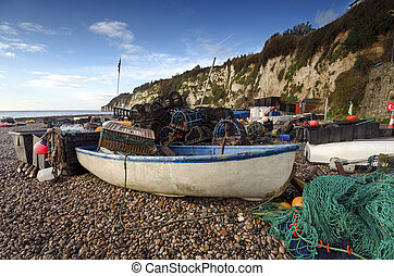 Fishing boat and nets on the beach in Devon