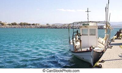 fishing boat and small port in crete, greece