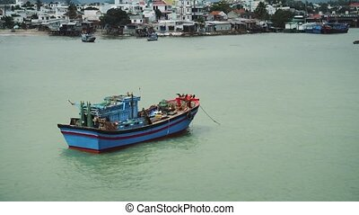 Fishing Boat At Anchor Off Poor Village In Nha Trang.