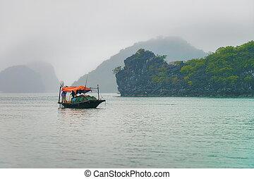 Fishing boat at Ha Long Bay Vietnam at sundown