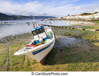 Fishing boat at low tide in Galicia