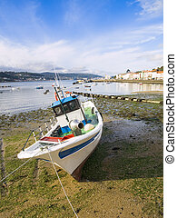 Fishing boat at low tide