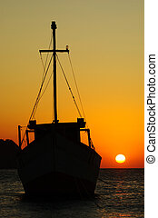 Fishing boat at sunset anchoring in the bay of Taganga on the Caribbean coast of Colombia