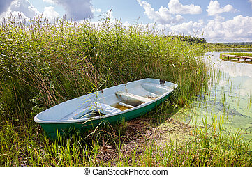 Fishing boat at the lake in summer sunny day