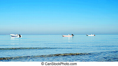 Fishing boat at the sea in sunny day