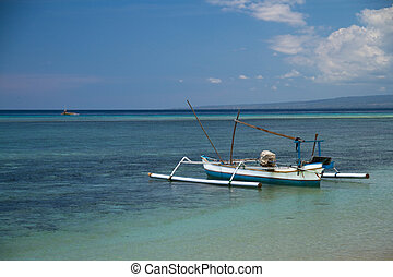 Fishing boat at turquoise reef