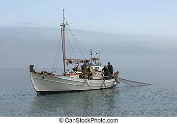 Fishing boat at work