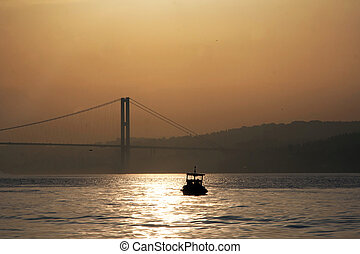 Fishing boat before bridge in Bosporus