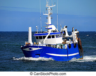 Fishing boat underway at speed over blue sky and sea.