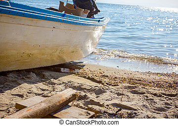 Fishing boat dry docked on the sandy beach
