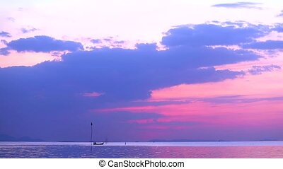 fishing boat find seafood on the sea and pastel purple pink sky color