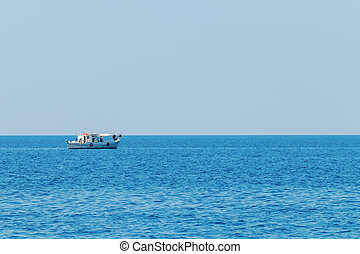 Fishing boat floating on the water, blue sea and sky