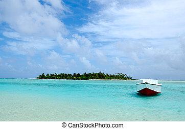 Small fishing boat in Aitutaki lagoon Cook Islands.