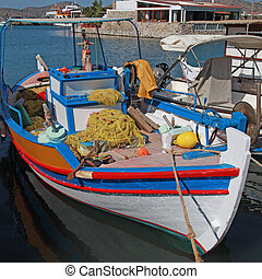 Fishing boat in Elounda (Crete, Greece). Square image