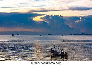 Fishing boat in sea on Koh Samui at amazing sunset