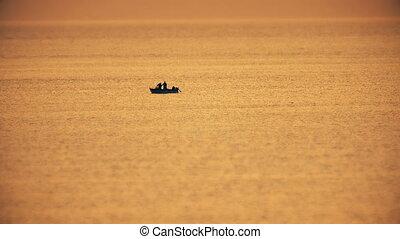 fishing boat in  sunset sea