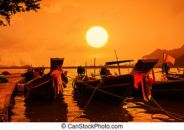 fishing boat in the sea at sunset background